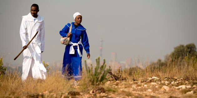 Worshippers arrives for an outdoor church service on the Melville Koppies Hill in Johannesburg on July...