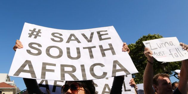 Demonstrators take part in a protest calling for the removal of South Africa's President Jacob Zuma in...