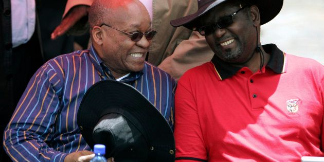 South Africa's President Jacob Zuma (L) chats with Zwelinzima Vavi