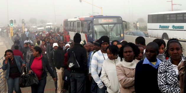 Commuters wait to board a bus during a strike in Soweto May 17, 2010. Talks between striking South African...