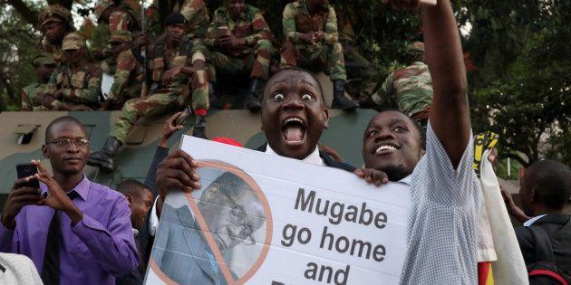 Zimbabweans celebrate after President Robert Mugabe resigns in Harare, Zimbabwe November 21, 2017. REUTERS/Philimon...