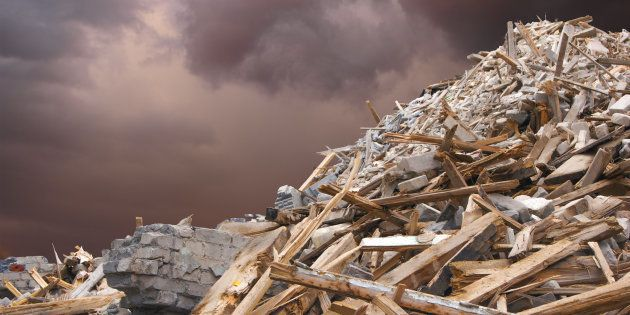 Destroyed building and debris after a strong