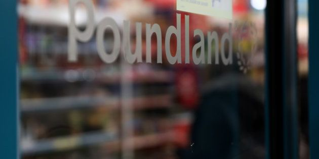 A Poundland logo sits at an entrance to a Poundland Group Ltd. discount retail store, operated by Steinhoff...