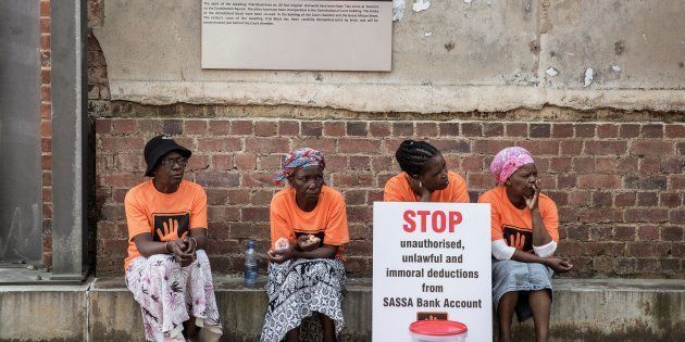 A member of the South African Human rights Non Governmental Organisation Black Sash holds a placard outside...