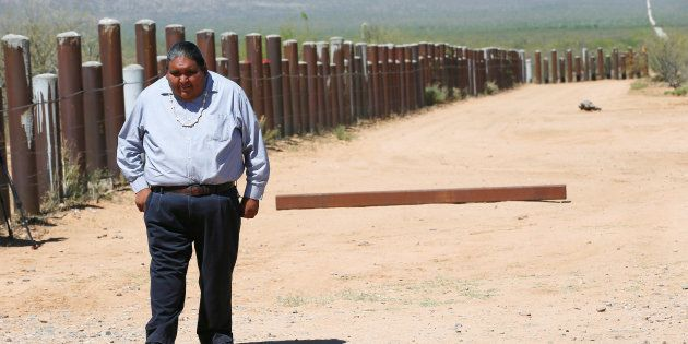 Verlon Jose, vice-chairman of the Tohono O'odham Nation, walks along the vehicle barrier on the U.S.-Mexico...