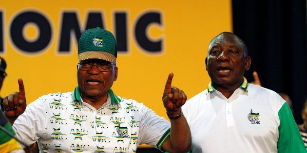 President Jacob Zuma sings next to newly elected president of the ANC Cyril Ramaphosa during the 54th...