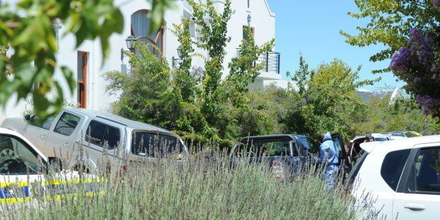 Police forensic investigators at De Zalze Golf Estate where three family members were hacked to