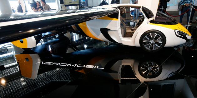 People look at the AeroMobil flying car during its unveiling at the Top Marques Monaco supercar show...