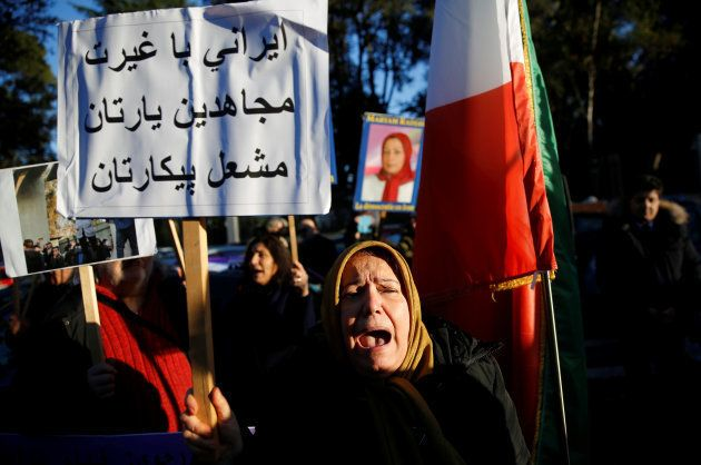 Opponents of Iranian President Hassan Rouhani hold a protest outside the Iranian embassy in Rome, Italy,...