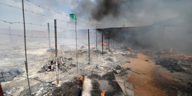 The chaotic scene of the violent protests which left two homes reduced to ashes on April 25, 2017 in...