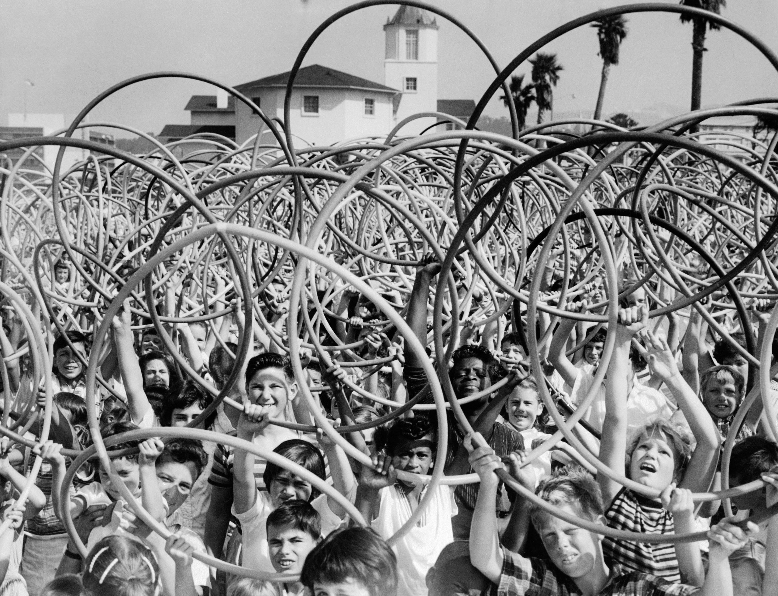 Kids hold up toy hoops in San Francisco circa 1958.