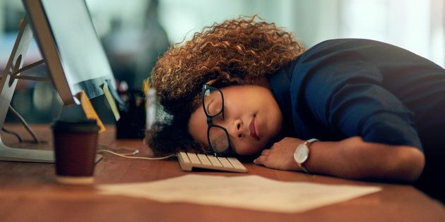 Shot of an exhausted young businesswoman sleeping at her desk during a late night at