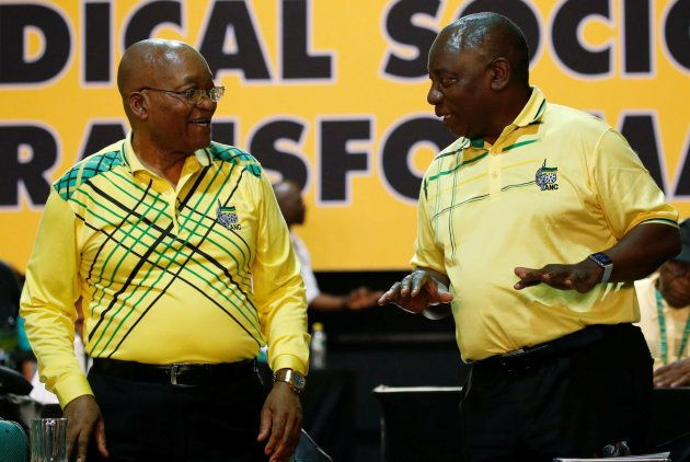 Deputy president of South Cyril Ramaphosa (R) chats with President of South Africa Jacob Zuma during...