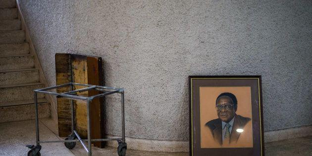 TOPSHOT - A picture taken on December 14, 2017 shows a portrait of former Zimbabwe President Robert Mugabe...