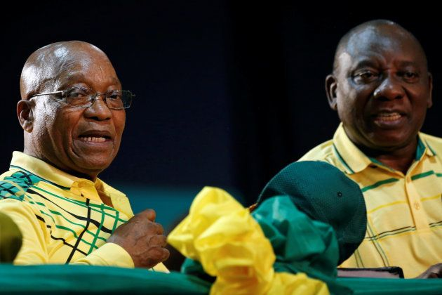 President of South Africa Jacob Zuma sits next to his deputy Cyril Ramaphosa at the 54th National Conference...