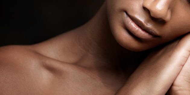 Cropped image of an african beauty with flawless skin sleeping against a black