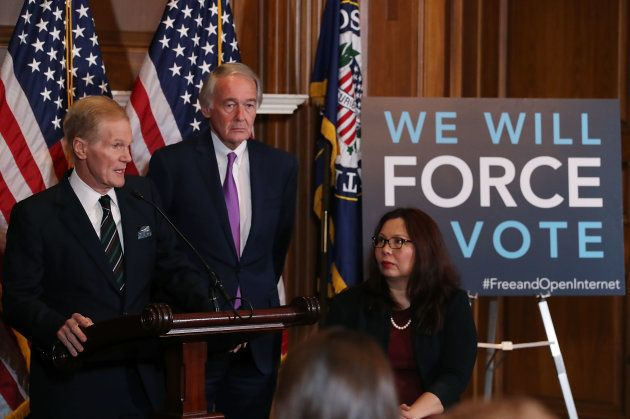 Sen. Bill Nelson (D-FL) (L) is flanked by Ed Markey (D-MA) and Tammy Duckworth (D-IL)while speaking about...