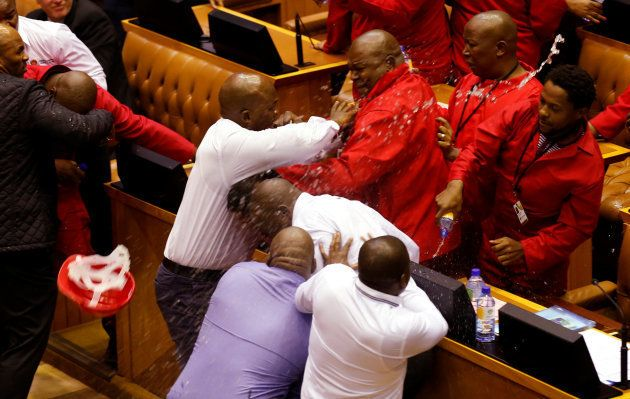 Party leader Julius Malema and members of his Economic Freedom Fighters (EFF) clash with Parliamentary...