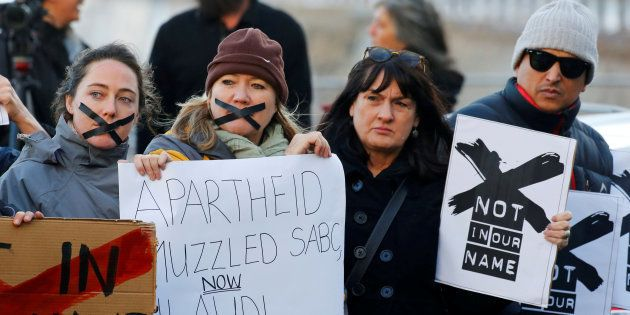Demonstrators protest against the decision by public broadcaster the South African Broadcasting Corporation...