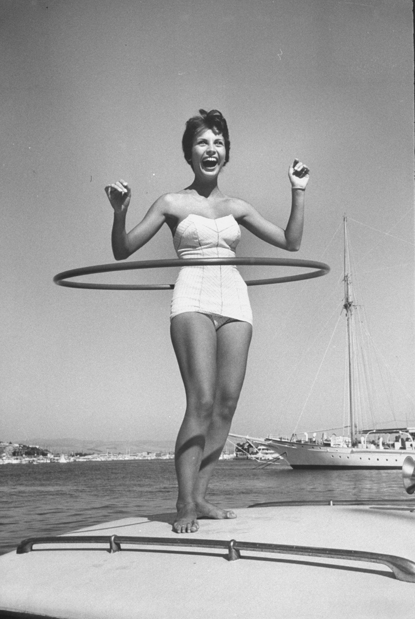 Bonnie Manchester demonstrates a hoop in Newport Beach, California, in 1958.