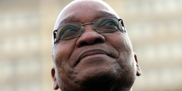 Former South African deputy-President Jacob Zuma smiles at supporters after his acquittal on rape charges,...