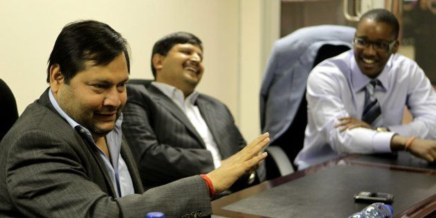 JOHANNESBURG, SOUTH AFRICA - 4 March 2011: Indian businessmen Ajay and Atul Gupta, and Sahara director,...