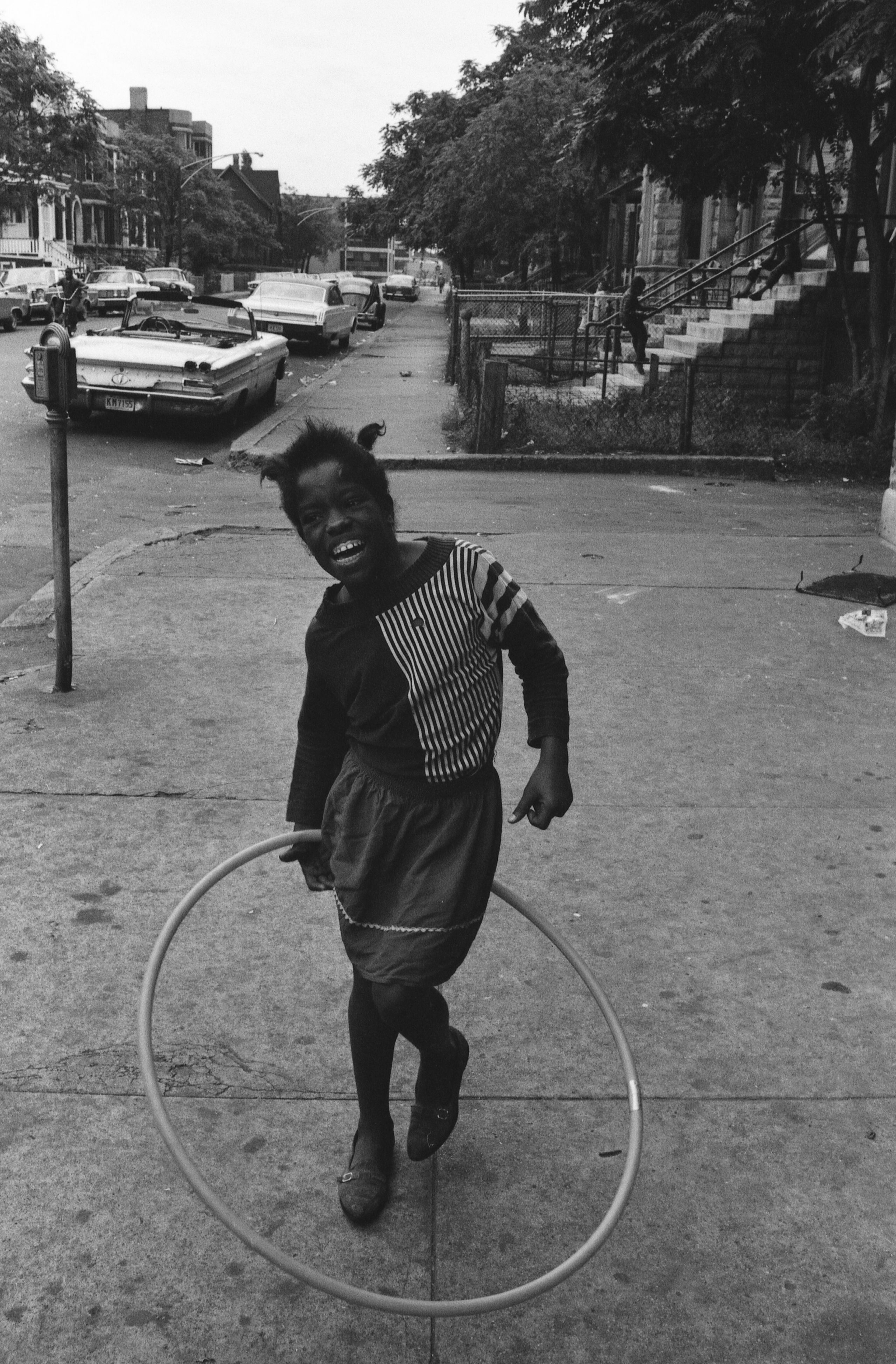 A girl twirls a toy hoop in Chicago sometime in the mid- to late 1960s.