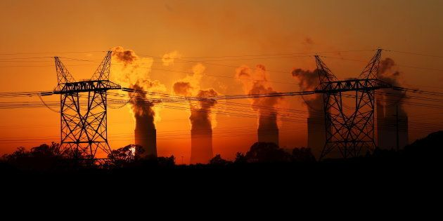 Electricity pylons are seen in front of the cooling towers at the Lethabo Thermal Power Station, an Eskom...