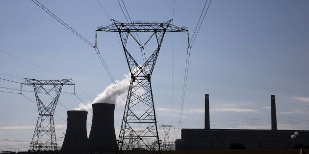 Eskom electricity pylons near Arnot Power Station's cooling towers in Mpumalanga South