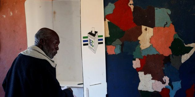 A man casts his ballot during the national elections at Ha-Mampho Village outside the capital Maseru,...