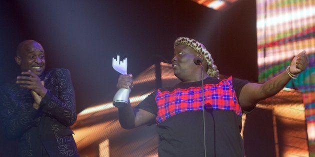 L'vovo derrango celebrates receiving the 'Best Kwaito Album' from Arthur Mafokate during the 16th annual...