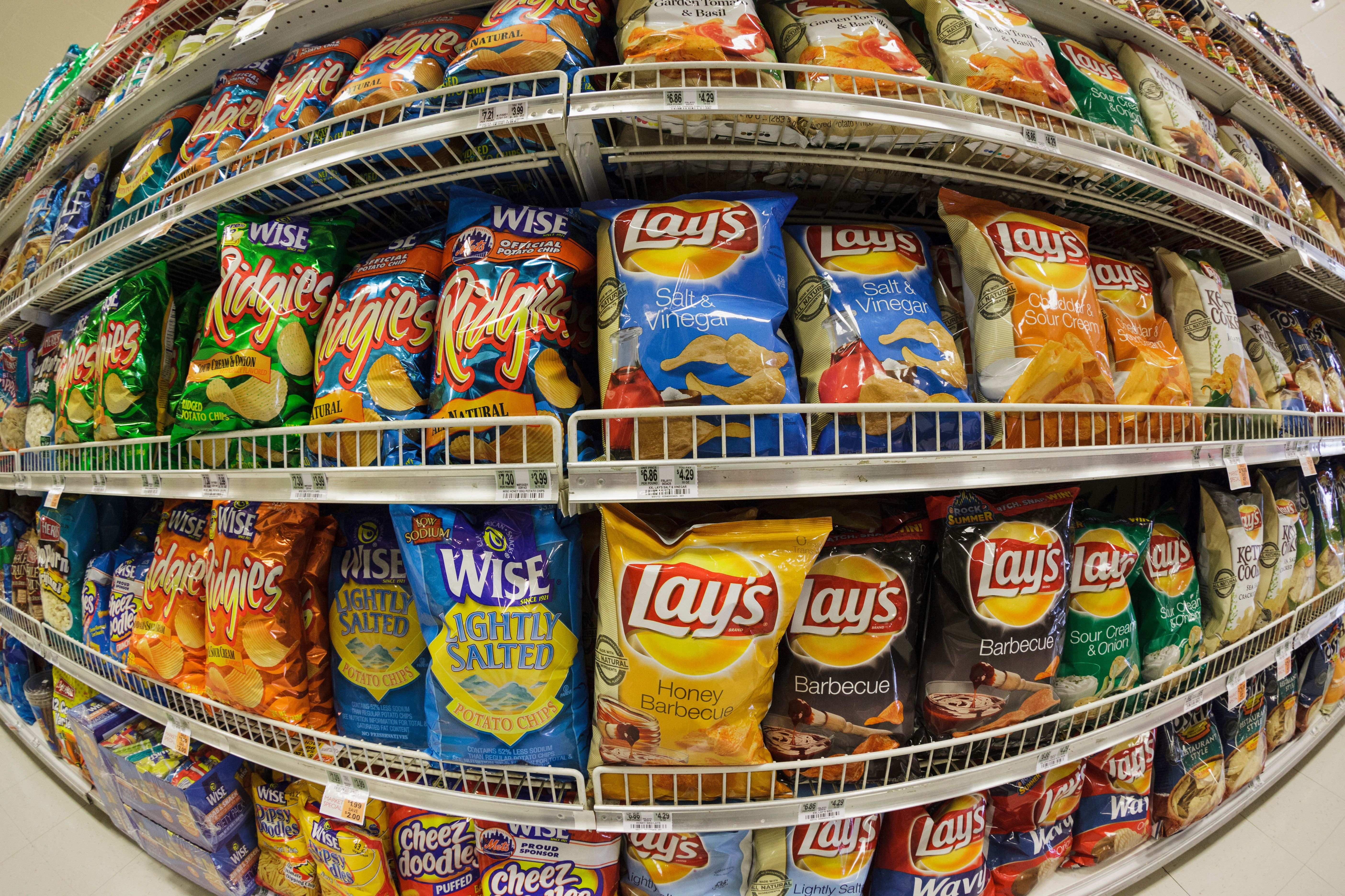 A supermarket shelf at a Kings Food Market in Midland Park, New Jersey filled mostly with Frito-Lay brands of chips. (Photo by James Leynse/Corbis via Getty Images)