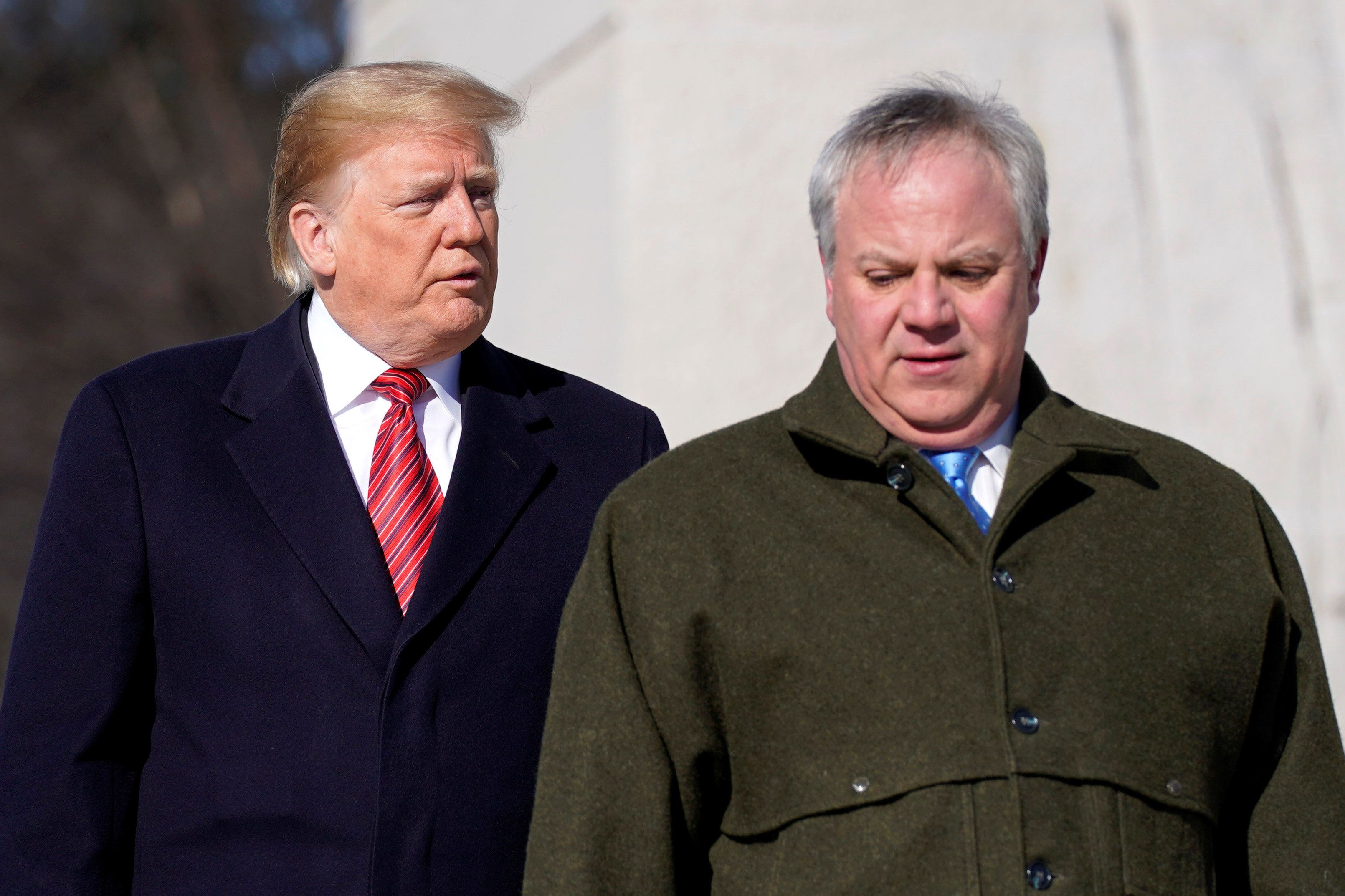 U.S. President Donald Trump and acting U.S. Secretary of Interior David Bernhardt arrive to place a wreath at the Martin Luther King Memorial in Washington, U.S., January 21, 2019.      REUTERS/Joshua Roberts