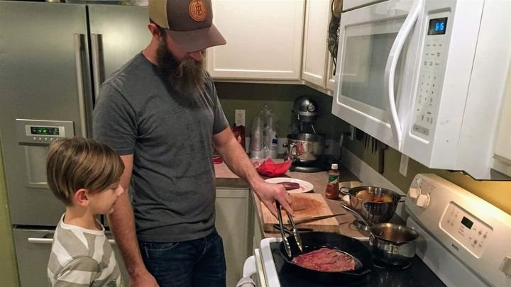 Nate Lindskoog and his son Jett, 8, cook venison tacos in their Nampa, Idaho, home. The deer was killed by a car a year earli