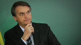 Jair Bolsonaro, Brazil's president, listens during a joint news conference with Juan Guaido (not pictured), president of the National Assembly who swore himself in as the leader of Venezuela, not pictured, at the Planalto Palace in Brasilia, Brazil, on Thursday, Feb. 28, 2019. Guaido traveled to Brasilia from Colombia, despite a travel ban imposed by Venezuelan President Nicolas Maduro, for talks aimed at securing support from Bolsonaro. Photographer: Andre Coelho/Bloomberg via Getty Images