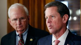 Gov. Brian Kemp holds a press conference with Agriculture Commissioner Gary Black in support of relief for hurricane damage in south Georgia Wednesday, Feb. 27, 2019 in Atlanta.  (Bob Andres/Atlanta Journal-Constitution via AP)