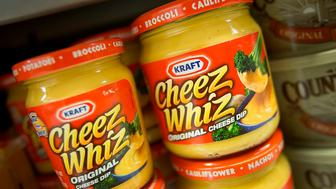Jars of Kraft Foods Group Inc. Cheez Whiz are displayed for sale at a supermarket in New York, U.S., on Monday, Nov. 5, 2012. Kraft Foods Group Inc. is scheduled to release earnings data on Nov. 7. Photographer: Scott Eells/Bloomberg via Getty Images