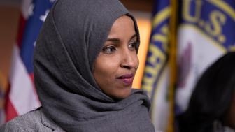 Rep.-elect Ilhan Omar, D-Minn., joins House Democratic Leader Nancy Pelosi of California and newly-elected members at a news conference to discuss their priorities when they assume the majority in the 116th Congress in January, at the Capitol in Washington, Friday, Nov. 30, 2018. (AP Photo/J. Scott Applewhite)