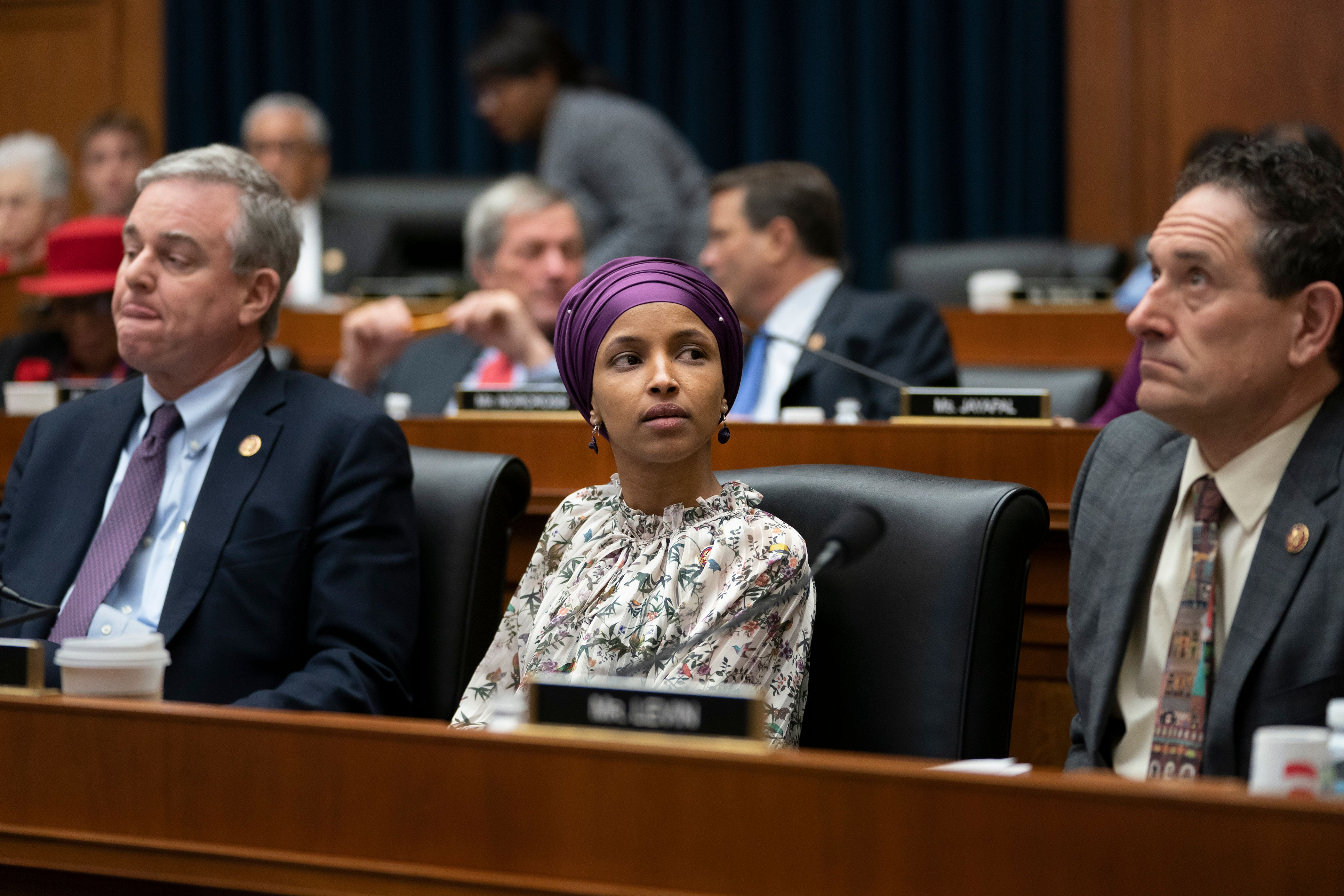 "Rep. Ilhan Omar, D-Minn., sits with fellow Democrats, Rep. David Trone, D-Md., left, and Rep. Mike Levin, D-Calif., right, on the House Education and Labor Committee during a bill markup, on Capitol Hill in Washington, Wednesday, March 6, 2019. Omar stirred controversy last week saying that Israel's supporters are pushing U.S. lawmakers to take a pledge of ""allegiance to a foreign country."" Omar is not apologizing for that remark, and progressives are supporting her. (AP Photo/J. Scott Applewhite)"