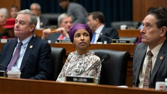 """Rep. Ilhan Omar, D-Minn., sits with fellow Democrats, Rep. David Trone, D-Md., left, and Rep. Mike Levin, D-Calif., right, on the House Education and Labor Committee during a bill markup, on Capitol Hill in Washington, Wednesday, March 6, 2019. Omar stirred controversy last week saying that Israel's supporters are pushing U.S. lawmakers to take a pledge of """"allegiance to a foreign country."""" Omar is not apologizing for that remark, and progressives are supporting her. (AP Photo/J. Scott Applewhite)"""