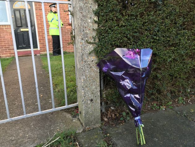 Floral tributes at the property where the victims were