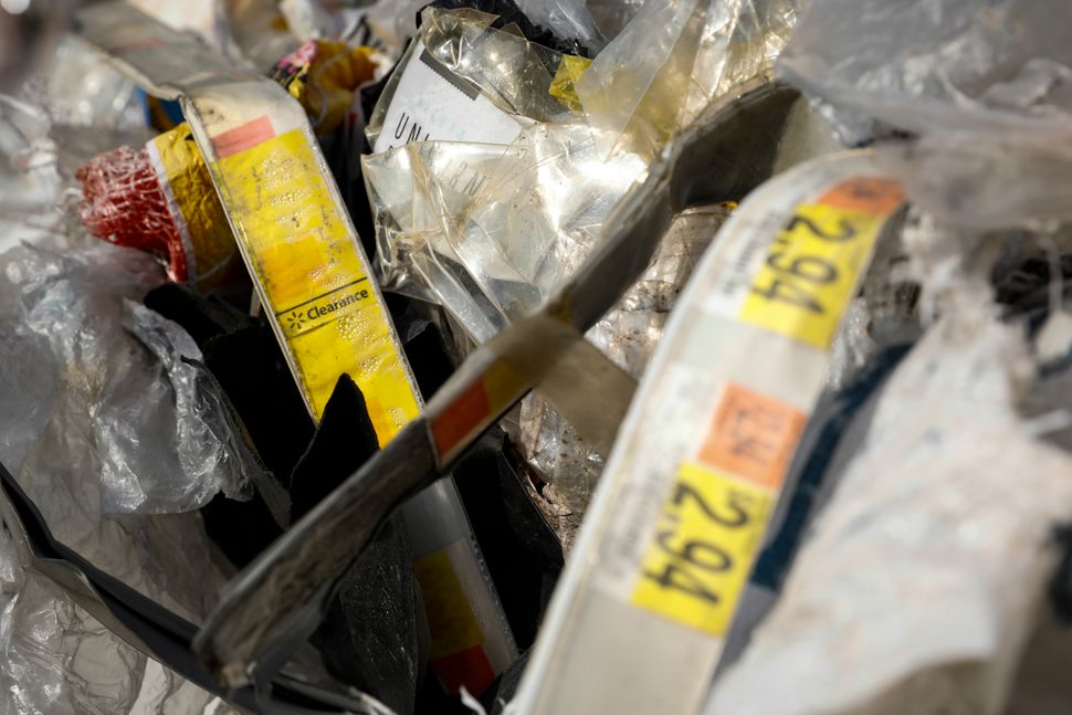 A Walmart clearance tag in a plastic bale at a dumpsite in Ipoh, Malaysia, Jan. 30. U.S. companies may...