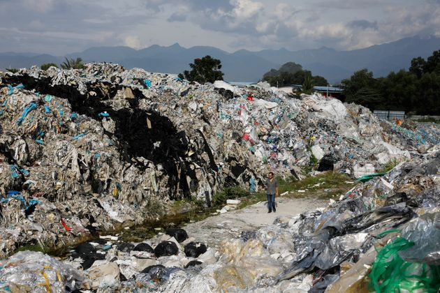 A Greenpeace activist at a dumpsite in Ipoh, Malaysia, on Jan. 30. Unlicensed recyclers are illegally...