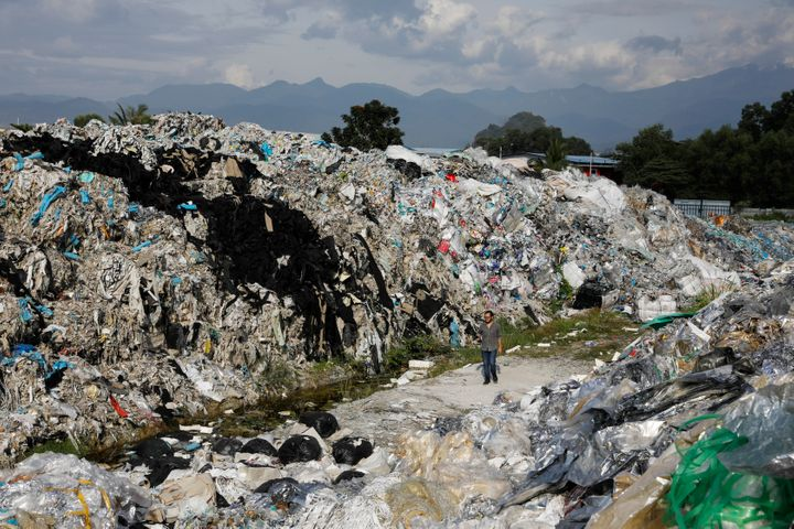 Mountains of plastic waste dumped outside an illegal recycling facility in Malaysia.