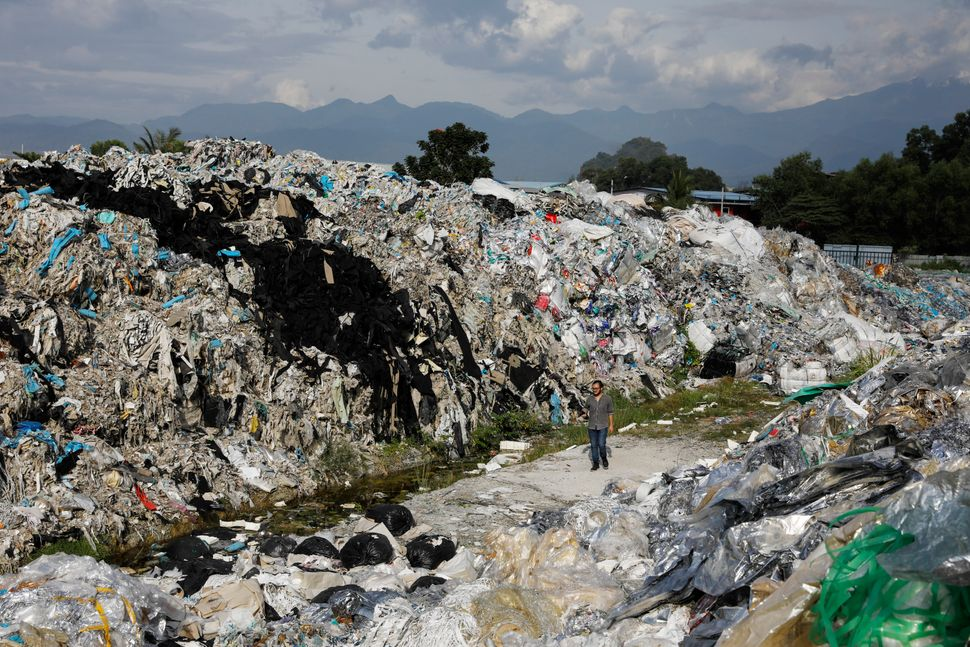 A Greenpeace activist at a dumpsite in Ipoh, Jan. 30. Unlicensed recyclers are illegally burning or dumping...