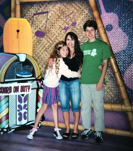 """Me, my mom and my brother in 2004 having dinner at a restaurant where you could meet Disney characters. Our trips to Disney were always so complicated for me. I loved Disney and wanted to be able to just enjoy it, but instead I'd spend the days leading up to the trip looking up the menu, planning exactly what I would eat, calculating the calories I'd consume, and starving myself as much as possible to """"save room"""" for the """"big meal"""" ― at which I'd wind up restricting myself anyway. At least I always got a hug from Baloo!"""
