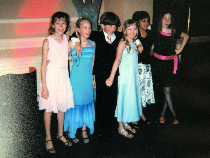 """Me with my childhood friends Danielle Chuchran, Dylan Meyer, Megan, Tessa, and Caitlin Meyer at the Young Artist Awards in 2003. I was 12 and really struggling with anorexia, so any sort of social eating like at this luncheon was genuinely my nightmare. The woman sitting next to me at our table noticed I was fiddling with my roll instead of eating it and commented loudly, """"You haven't eaten a thing!"""" I seethed with anger that this woman almost blew my cover as a closeted anorexic."""
