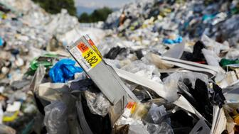 A price tag is pictured inside a plastic bale at a dumpsite in Kelebang, Ipoh, Malaysia, Wednesday, Jan. 30, 2019. (Joshua Paul for Huff Post)