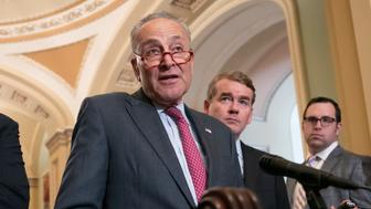 Senate Minority Leader Chuck Schumer, D-N.Y., flanked by Sen. Martin Heinrich, D-N.M., left, and Sen. Michael Bennet, D-Colo., speaks with reporters following their weekly policy meetings, at the Capitol in Washington, Tuesday, Aug. 28, 2018. (AP Photo/J. Scott Applewhite)