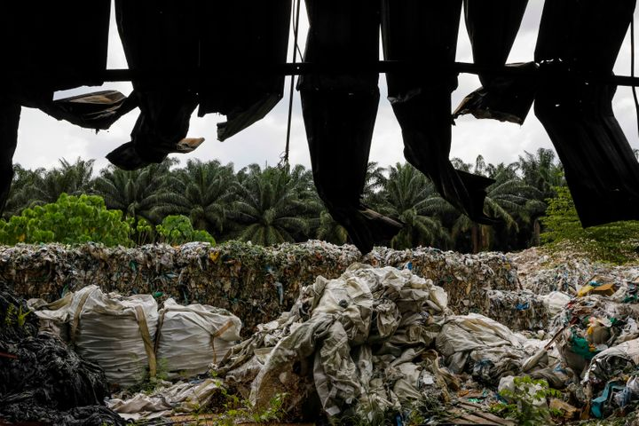 Plastic bales behind burned fencing at an illegal recycling site near Jenjarom, Malaysia, on Feb. 2. After China clamped down